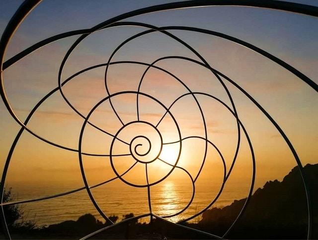 Atardecer desde el monumento de la Caracola en el Cabo Home
